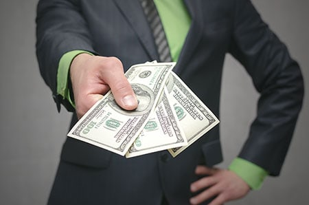 Businessman with outhstretched hand gesturing for you to get money