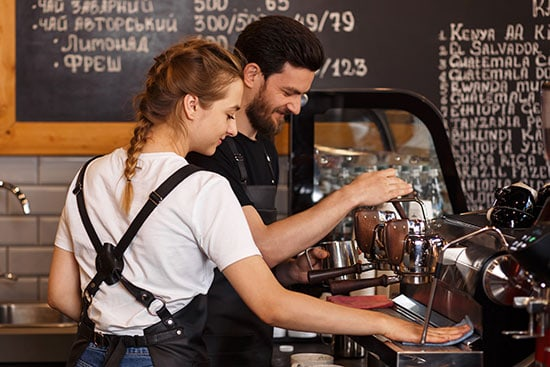 two-young-baristas-brewing-coffee-starting-coffee-shoop-business-concept