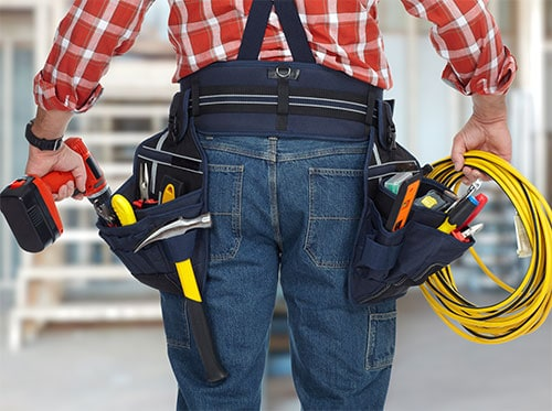 Electrical contractor with tool belt carrying yellow cable